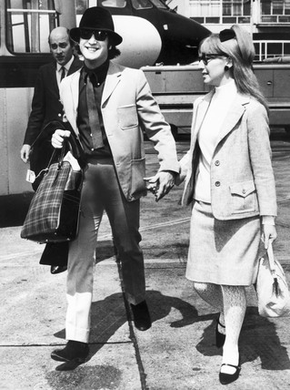 John and Cynthia Lennon, London Airport, 1965.