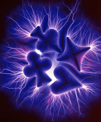 Kirlian photograph of poker symbols.