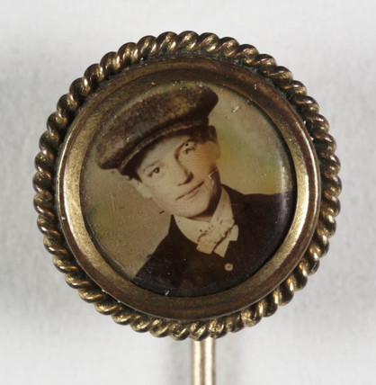 Pin containing a portrait of a young man, c.1900.
