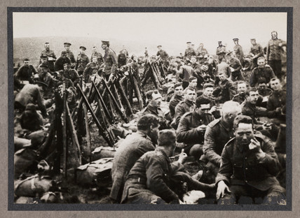 Soldiers eating, c 1915.