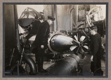 Inspecting a torpedo, c 1916.
