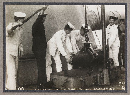 'Lowering 15 inch Shells Into Magazine', c 1916.
