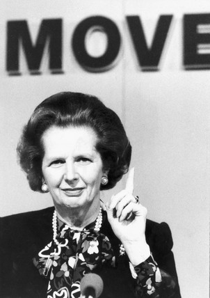 Margaret Thatcher pointing and smirking, June 1987.