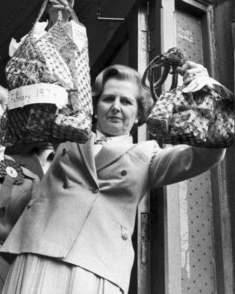 Margaret Thatcher with shopping, c 1979.