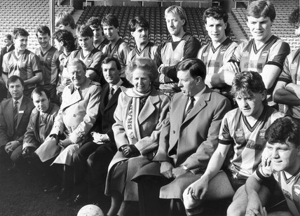 Margaret Thatcher with the Bradford football team, February 1987.