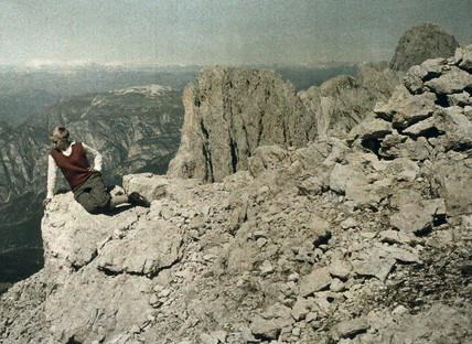 Eva seated on a rocky bluff, Rotwand, Dolomites, 1929.