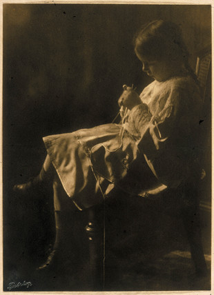 Girl knitting, 1905.