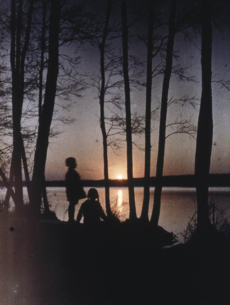 Children at sunset, c 1920s.