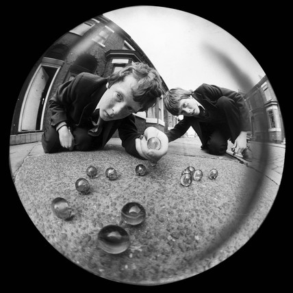 Boys playing marbles, 1980.