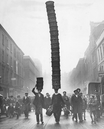 Covent Garden porter carrying a basket 'Eiffel Tower', 1928.