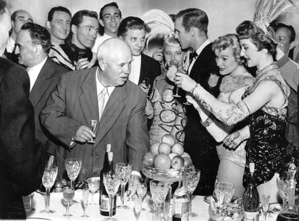 Khrushchev drinking with American show-girls, 1959.