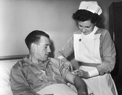 British footballer Nat Lofthouse getting an injection, November 1955.