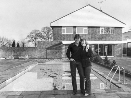 Glenn Hoddle and his wife Anne by their pool, January 1982.