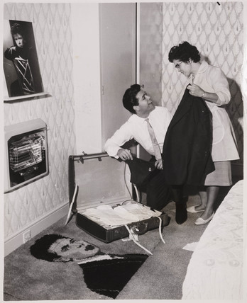 Cliff Richard packs with the help of his mother, 10th October 1961.