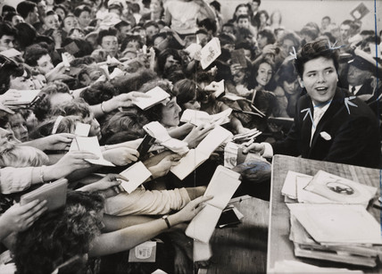 Cliff Richard mobbed by fans, London, 1959.