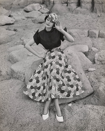 'Woman in patchwork skirt and hat', c 1960.