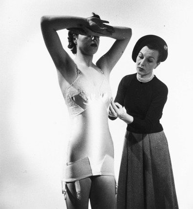 Model wearing an all-in-one bra and corset, c 1950s.