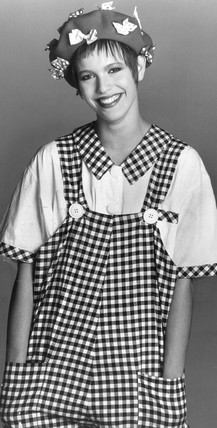 Woman wearing gingham dungarees, January 1985.