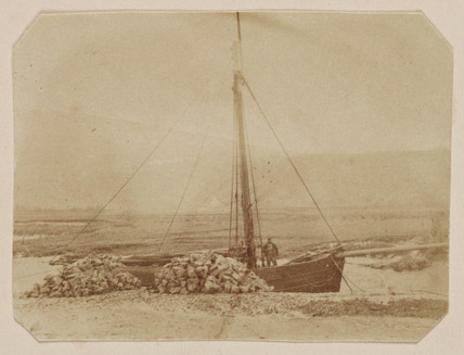 Boat and quarried stone, Wales, c 1860s.