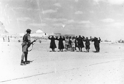 An Italian garrison surrendering to their Australian conquerors, 17 May 1941.