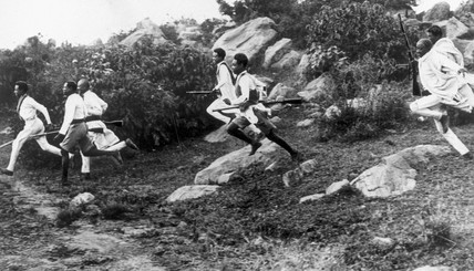 Young Abyssinian warriors running to reach cover, 24th October 1938.