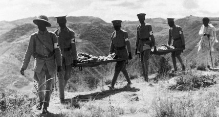 The Red Cross carrying casualties, c 1936.