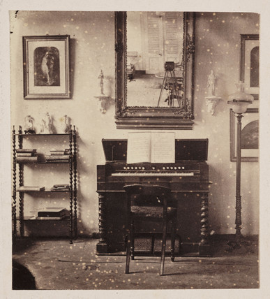 Interior with a camera reflected in a mirror, c. 1860.
