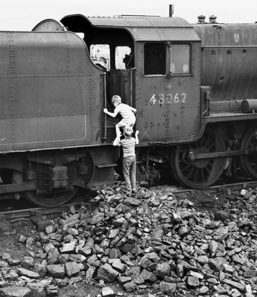 Children play on a locomotive, August 1968.