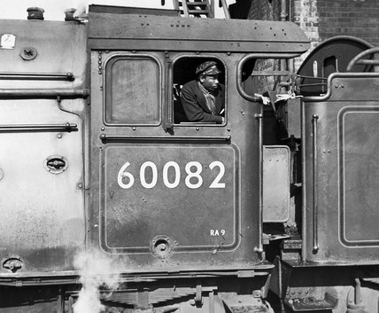 Afro-Caribbean fireman on the 'Neil Gow' steam locomotive, 17 May 1962.