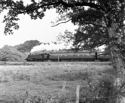 A steam train approaches Lymington Junction, Hampshire, 1966.