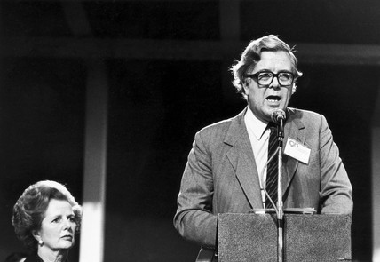 Margaret Thatcher listening to Geoffrey Howe, Blackpool, October 1981.