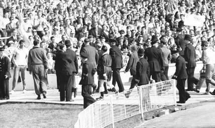 Referee being escorted from the pitch, World Cup, Wembley, July 1966.