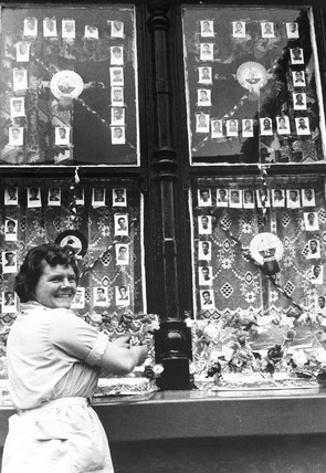 Woman decorating her window for the World Cup, July 1966.