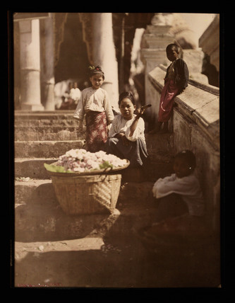 Flower sellers on steps.