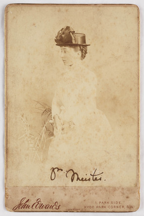 Portrait photograph of a woman in a straw hat, c 1860.