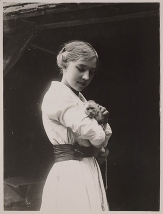 Young woman with a monkey, early 20th century.