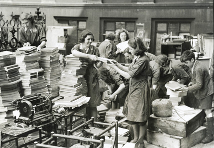 Women sorting clearing up after a German bombing raid, 1940s.