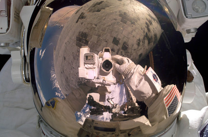 Self-portrait during a spacewalk, 3 August 2005.