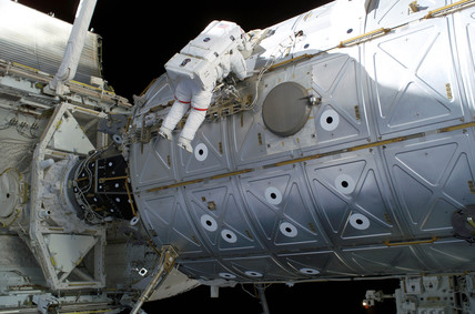 Astronaut repairing the International Space Station, 3 August 2005.