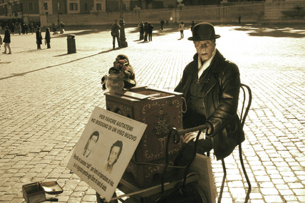 Organ grinder in the Piazza del Popolo, Rome, 2004.