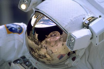 Astronaut spacewalking, 1999.