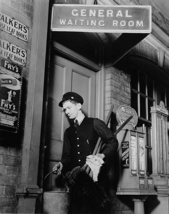 Porter at Hatch End Station, 1937.
