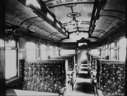 Interior of a third class dining car.