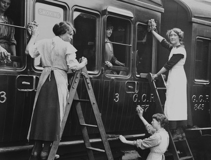 Women cleaning a train carriage, c 1918.