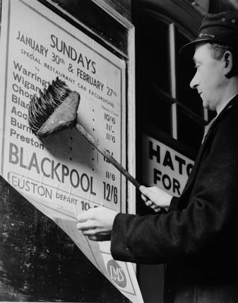 Guard posting a notice, 1937.