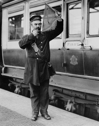 A guard at Holyhead station platform, c 1905.