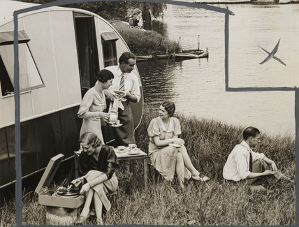 Caravanners having tea by a lake, June 1934.