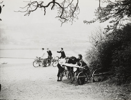 Cyclists studying maps, 15 April 1938.