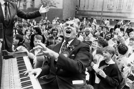 Dennis Healey playing the piano at Huddersfield Town Hall, May 1987.