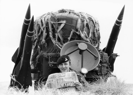 British soldier with special Falklands edition of the 'Star', December 1982.